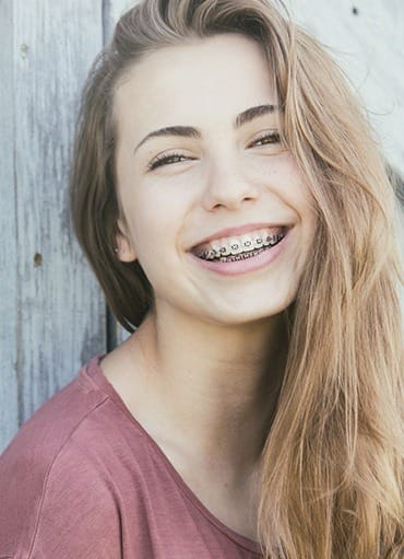 Smiling teen girl with braces