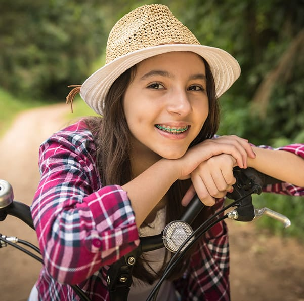 Young girl with braces smiling outdoors