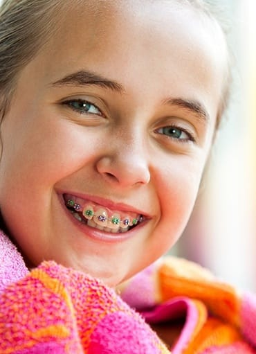 Girl in colorful scarf with traditional braces in Glenpool