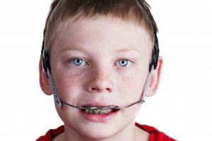 Boy wearing orthodontic headgear in Glenpool