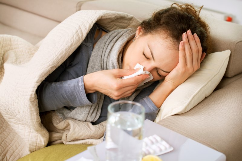 Sick woman resting on the couch